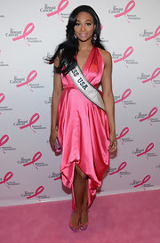Nana Meriwether chose a pink satin dress with a high-low fishtail hem for her elegant look at the Hot Pink Party in NYC.