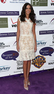 Terri Seymour kept her red carpet look fun and feminine with this floral lace frock.