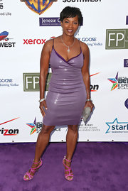 Vanessa Bell Calloway chose a lavender frock with a metallic sheen for her look on the also purple carpet at the Jenesse Silver Rose Awards Gala.