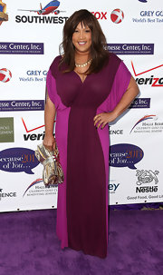 Kym Whitley chose a two-toned purple frock for her cool and colorful purple carpet look.