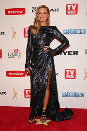 Sonia Kruger looked totally sleek and modern in this long-sleeved, sequined gown, featuring a high leg slit.