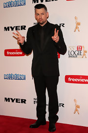 Joel Madden traded in his punk duds in favor of this sleek black suit.