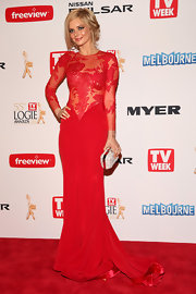Samara Weaving stunned in a fitted red gown that featured a sheer lace bodice and sleeves, as well as a gorgeous fit and flare mermaid skirt.