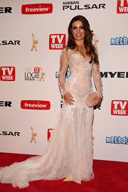 Ada Nicodemou stunned in sheer white lace at the 2013 Logie Awards red carpet.