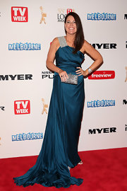 Julia Morris chose a midnight blue gown with a silver sequined shoulder strap and flowing train for her red carpet look.