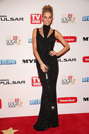 Jennifer Hawkins chose a dazzling sequined dress, which featured a high neck piece, for her look at the 2013 Logie Awards.