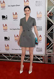 Krysten Ritter paired white pointy pumps with her trendy dress for a classic finish.