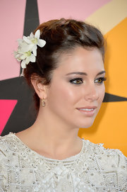 Bianca Suarez chose a braided updo accentuated with a white flower for her soft and romantic look on the red carpet.