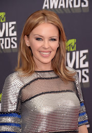 A subtle glossy lip topped off Kylie Minogue's minimal makeup look.