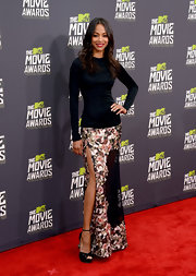Zoe Saldana showed off her long limbs in this gorgeous black dress that features a rose-print skirt.