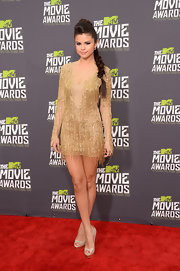 Selena Gomez looked absolutely stunning in a beaded gold, fringed dress.
