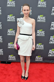 Taissa Farmiga rocked a one-shouldered black-and-white dress that featured a ruffled shoulder and a peplum waist.