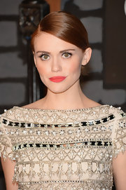 Holland topped off her crisp and classic look with a simple but chic low bun.