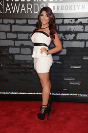 Deena's strapless white-and-black peplum dress definitely showed off her figure at the 2013 VMAs.