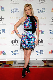 Holly Madison rocked a bold printed dress with a black belt and halter neck.
