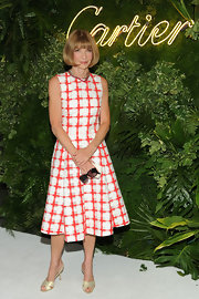 Anna Wintour stuck to her signature classic lady-like look with this white and red checked A-line frock.