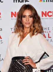 Jessica Alba curled her hair into loose waves for the 2013 NCLR ALMA Awards.