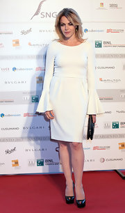 Claudia Gerini chose a crisp white frock with bell sleeves for her look on the red carpet.