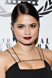 Melonie Diaz swiped on some dark red lipstick for a bold beauty look during the NY Film Critics Circle Awards.