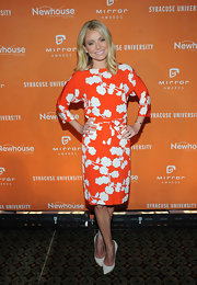Kelly Ripa's bright orange dress featured crisp white floral details for a big and bold summmertime look.