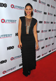 Miranda Rae Mayo chose a black tiered dress with a sheer mesh plunging neck.