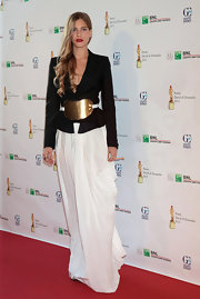 Tea sported a classic structured black blazer with her flowing skirt for an interesting mix of styles.