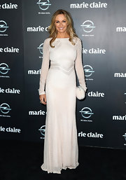 Charlotte Dawson sported a long-sleeve, white gown with chevron patterns for her evening look.
