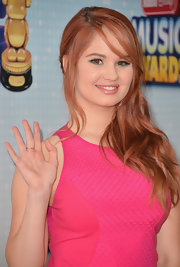 Debby Ryan pulled back her strawberry locks into a side-swept, wavy 'do.