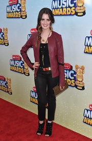 Laura Marano chose a pair of snakeskin textured slacks for her cool and edgy red carpet look.