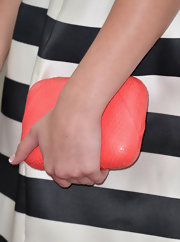 A peach clutch added some color to Olivia Holt's black-and-white frock.