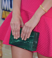 Debby Ryan added an unexpected dash of color to her hot pink frock with this green marble clutch.