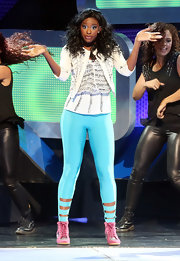 Coco Jones layered a studded cropped white jacket over her glitzy top during her performance at the Radio Disney Music Awards.