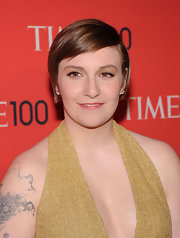 Lena stuck to a simple red carpet beauty look with a pink tinted lip gloss.