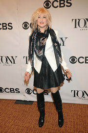 Cyndi Lauper rocked a black leather skirt with pleats for her punk-inspired look at the Tony Awards Nominees Reception.