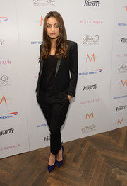 Mila Kunis avoided a monotonous look by pairing blue pointy pumps with her all-black outfit during her visit to the Variety Studio.