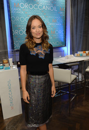 Olivia Wilde chose a black top with a meshwork neckline for her visit to the Variety Studio.