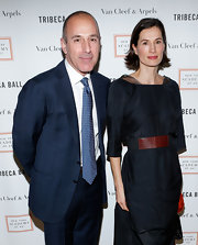 Annette Lauer accentuated her slim waist by cinching her black dress with an elastic belt at the 2013 Tribeca Ball.
