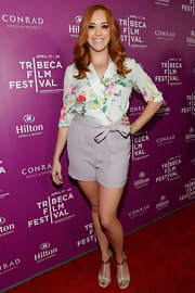 Andrea Bowen paired this floral blouse with pastel shorts for a totally light and feminine red carpet look.