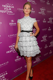 Sasha Pieterse was totally fun and flirty on the red carpet where she donned this black and white, ruffle tiered frock.
