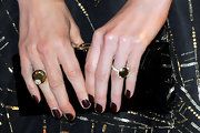 Kate Beckinsale opted for a classy and elegant titanium and gold cocktail ring for her Oscar-night look.