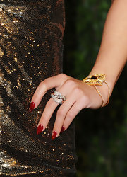 A strawberry gold ring with chocolate and vanilla diamonds topped off Vanessa Hudgens' Oscar party look.