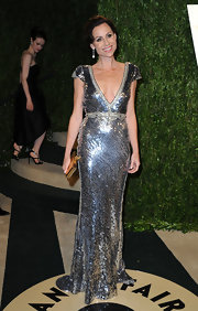 Minnie Driver showed off some sparkle with a silver sequin gown with a deep v-neck while at the Vanity Fair Oscar party.