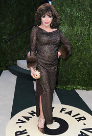 Joan Collins looked as beautiful as ever in a shimmering evening dress with fur trimmings at the Vanity Fair Oscar Party.