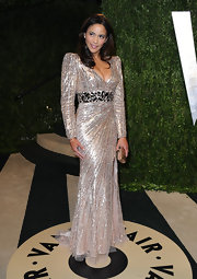 Paula Patton shimmered at Vanity Fair's Oscar Party in a gold and silver long-sleeved dress with wide waist band.