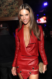Alessandra Ambrosio accessorized her sexy leather dress with a studded clutch when she attended the Victoria's Secret fashion show after-party.
