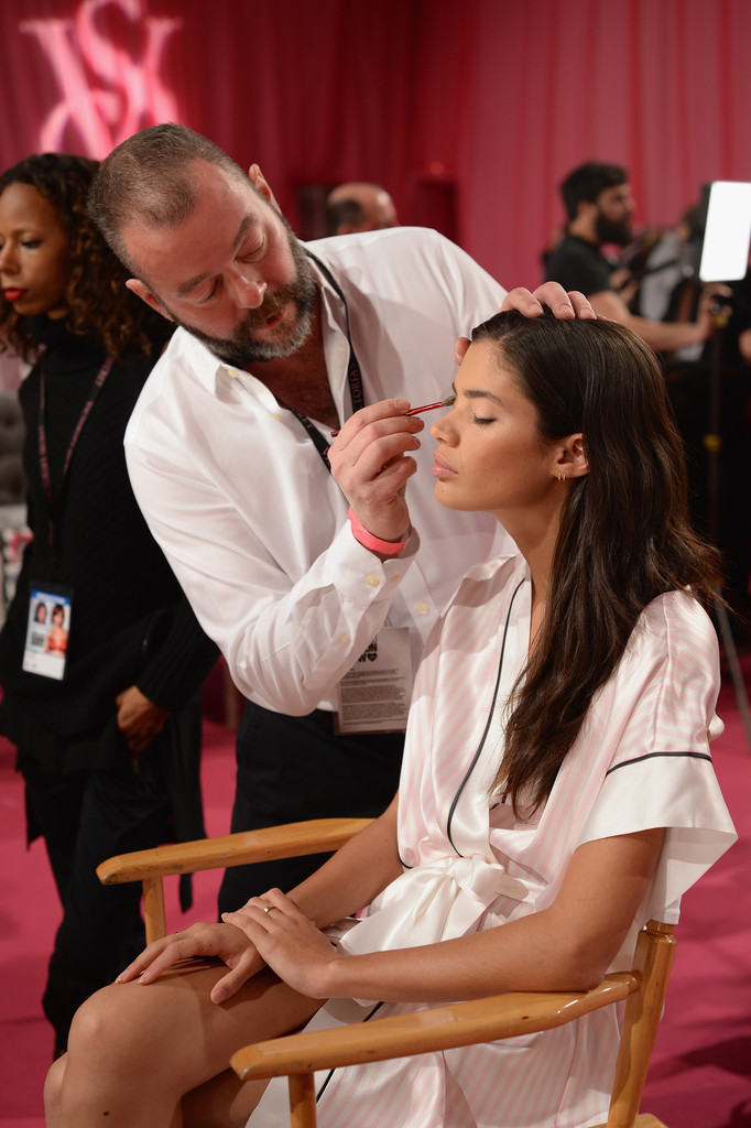 Lead Makeup Artist Dick Page demonstrates at the 2013 Victoria's Secret Fashion Show hair and make-up room at Lexington Avenue Armory on November 13, 2013 in New York City.