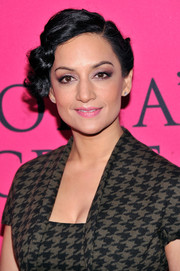 Archie Panjabi attended the Victoria's Secret fashion show looking retro-glam with her finger-wave updo.