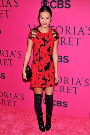 Jamie Chung looked vampy in a red and black Parker mini dress with shoulder cutouts during the Victoria's Secret fashion show.