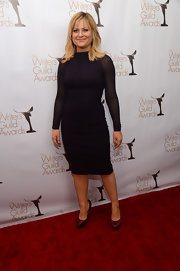 Amy Poehler jumped in on the mesh trend in this tight eggplant body-con dress with sheer sleeves.