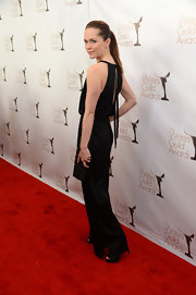 Katie Aselton wore a draped black gown with an open back and dangling ties for the WGA Awards.